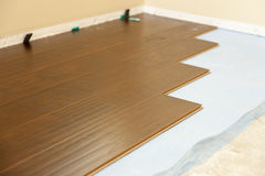 Newly Installed Brown Laminate Flooring. Abstract stock photos