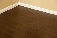 Newly Installed Brown Laminate Flooring and Baseboards in Home Stock Photography