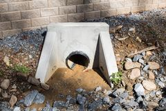 Newly installed drainage pipe and poured concrete form for water Royalty Free Stock Photo