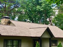 Newly installed Roof on House. Front of a house with new roof shingles installed stock image