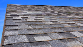 Newly Installed Roof with Textured Asphalt Shingles or Bitumen Tiles on the Rooftop Exterior. Newly Installed Roof with Textured Asphalt Shingles or Bitumen stock photos