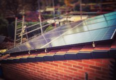 Newly installed solar panels. New installation of solar panels on a home in the uk Royalty Free Stock Image