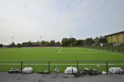 Newly laid artificial turf, football pitch on the football stadium.  stock photography