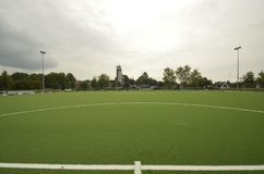 Newly laid artificial turf, football pitch on the football stadium.  stock image