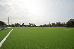 Newly laid artificial turf, football pitch on the football stadium.  royalty free stock images