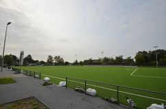Newly laid artificial turf, football pitch on the football stadium.  royalty free stock image