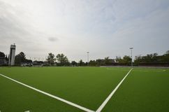 Newly laid artificial turf, football pitch on the football stadium.  stock images