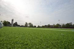Newly laid artificial turf, football pitch on the football stadium.  stock photos