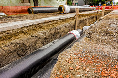 Newly laid pipe in a fresh trench. Unfinished pipeline Stock Photography