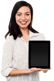 Newly launched tablet device in the market. Saleswoman presenting newly launched tablet device for sale Royalty Free Stock Photo