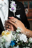 Newly married bride and groom hands with rings Stock Photos