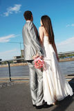 Newly-married couple. Against an under construction city royalty free stock photos