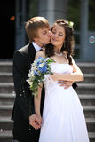 Newly Married couple. Groom kissing the bride on stair stock photography