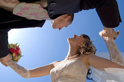 The newly married couple. Are take smb in hands look at clean blue sky Stock Photo