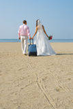 Newly married couple. Happy newly married couple to go  on a honeymoon ,  on  sea Stock Photos