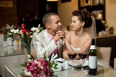 Newly married couple. Sit at table in restaurant, romance wedding dinner stock photo