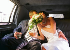 Newly-married couple. In a limousine Stock Photo