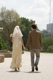 Newly-married couple. The newly-married couple leaves afar Royalty Free Stock Image