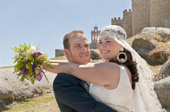 Newly married couple with the background wall Stock Images