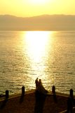Newly married couple on the beach. By sunset Royalty Free Stock Photography