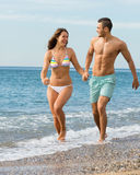 Newly married couple at the beach. Happy newly married couple having fun at the beach in honeymoon Stock Images