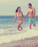Newly married couple at the beach Stock Photos