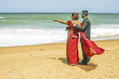 Newly married couple at a beach near Colombo, Sri Lanka. COLOMBO, SRI LANKA - AUG 18:  A newly married couple pose at the beach at a Poruwa on August 18, 2005 Royalty Free Stock Image