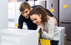 Newly married couple buying microwave oven in hypermarket Stock Image