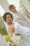 Newly-married couple among columns Royalty Free Stock Photography