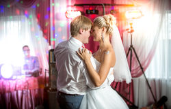 Newly married couple dancing at colorful lights and flares Royalty Free Stock Photo
