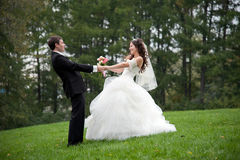 Newly married couple dancing in field Royalty Free Stock Photos