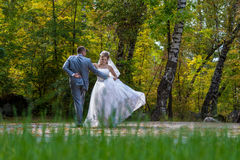 Newly married couple dancing in field. Royalty Free Stock Photography