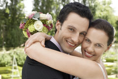 Newly Married Couple Embracing Royalty Free Stock Photo