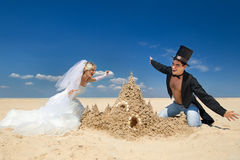 Newly-married couple enjoying on the beach Royalty Free Stock Photos