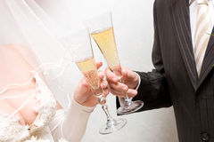 Newly-married couple with glasses Royalty Free Stock Photos