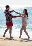 Newly married couple having homeymoon. Smiling newly married couple having homeymoon at tropical beach Stock Images