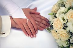 Newly married couple holding hands Royalty Free Stock Images