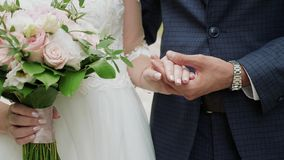 Newly married couple holding hands close-up stock image