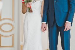 Newly-married couple holds hands 2314. Stock Photos