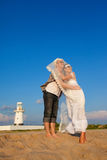 Newly-married couple on holiday. The groom and the bride against the dark blue sky Stock Image