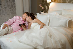 Newly married couple. In hotel room,  romance wedding night Royalty Free Stock Images