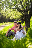Newly married couple hugging under tree at alley Royalty Free Stock Photo