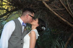 Newly Married Couple Kissing. Royalty Free Stock Photography