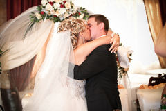 Newly married couple kissing passionately Stock Images