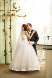 Newly married couple kissing at registry office Royalty Free Stock Images