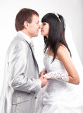 Newly married couple looking at each other Stock Images