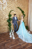 Newly married couple, loving couple before the wedding. Man and woman loving each other. Bride in the turquoise dress and groom Royalty Free Stock Images