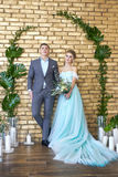 Newly married couple, loving couple before the wedding. Man and woman loving each other. Bride in the turquoise dress and groom. Newly married couple, loving stock images