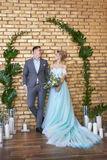 Newly married couple, loving couple before the wedding. Man and woman loving each other. Bride in the turquoise dress and groom. Newly married couple, loving stock image