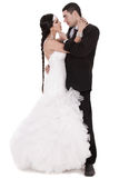 Newly married couple loving each other. Over white background Stock Photography